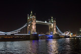 Night shot of the lit up Tower Bridge and Thames River. London.