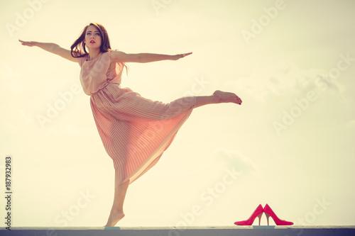 Woman dancing wearing long light pink dress - 187932983
