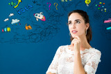 Young woman with many thoughts on a blue background - 187942766