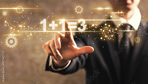 1 Plus 1 Equal 3 text with businessman on dark vintage background