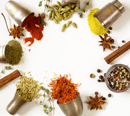 various aromatic spices in metal vintage bowls