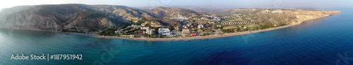 Papiers peints Chypre Aerial panoramic view of Pissouri bay, a village settlement between Limassol and Paphos in Cyprus. View of the coastline panorama, beach, hotel, resort, hills, plain and building developments.