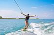 Quadro A woman wake boarding on tropical island. Beautiful tropical vacation on Bali.