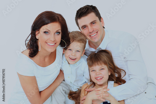 Beautiful happy family - isolated over a white background.