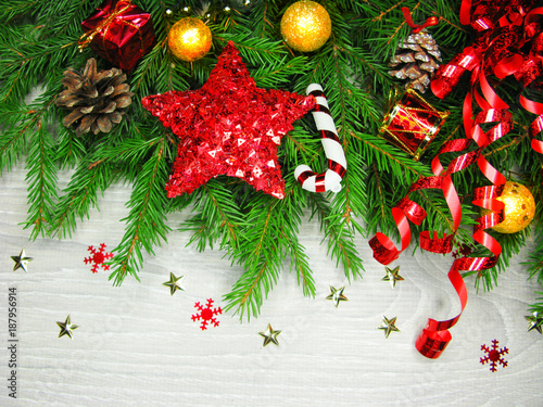 Foto Murales christmas decoration on fir branches background