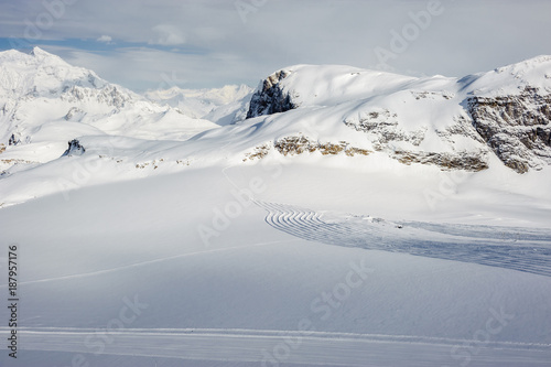 Fotobehang Bleke violet Alpine winter mountain landscape. French Alps with snow.