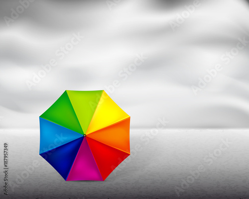 Colored umbrella on gray background
