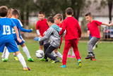 Young children players football match on soccer field - 187957553