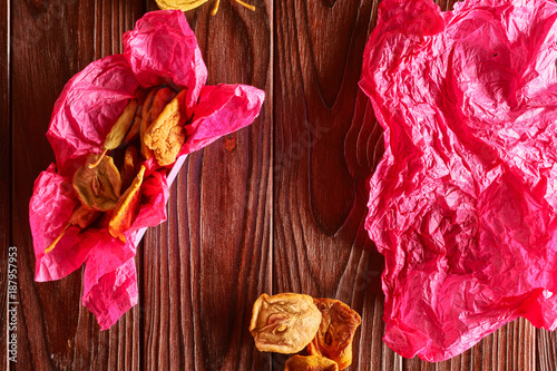 Foto Murales Dried fruits on wooden background