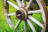 Old wooden cart wheel - 187972583