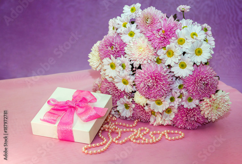 Beautiful white and pink aster and chrysanthemums bouquet -colorful fresh flowers arrangement, white present box with pink ribbon and pearl beads. - 187972781
