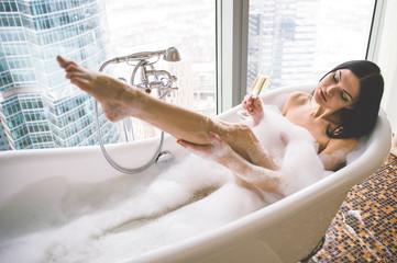 Seductive woman taking relaxing bath  © oneinchpunch