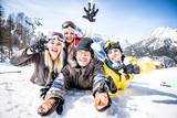 Group of friends having fun on the snow - 187974186