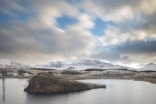 Fotobehang Blauwe jeans Beautiful long exposure Winter landscape image of Llyn y Dywarchen in Snowdonia National Park