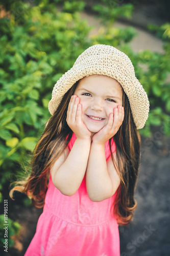 Foto Murales Spring is coming. Happy cute little girl outdoor