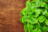 Mint leaves on a wooden background. Melissa - 187988919