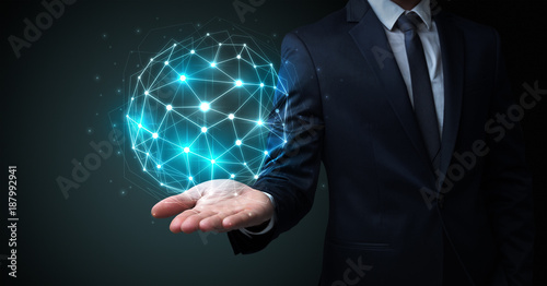 Foto Murales Businessman holding global connection concept