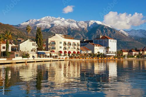 Fotobehang Natuur Park Winter Mediterranean landscape. Montenegro, embankment of Tivat city and snow-capped Lovcen mountain