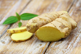 Fresh ginger on rustic wooden surface