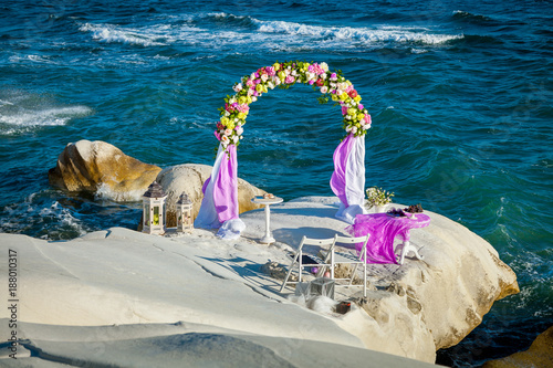 Papiers peints Chypre Wedding arch stands on white rocks on the beach