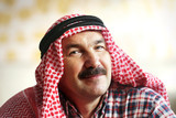 Happy arab man in arab kerchief - 188010952