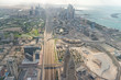 DUBAI, UAE - DECEMBER 9, 2016: Aerial view of Downtown skyline from helicopter. The city attracts 30 million tourists annually