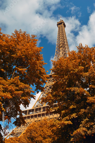 Sticker Eiffel Tower in autumn time.