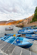 Scilla, Calabria. Docked boats in the city port at summer sunset, Italy