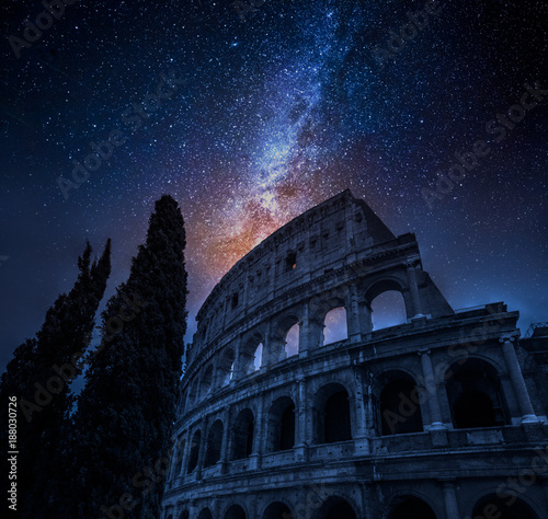 Foto Murales Beautiful Colosseum in Rome at night and milky way, Italy