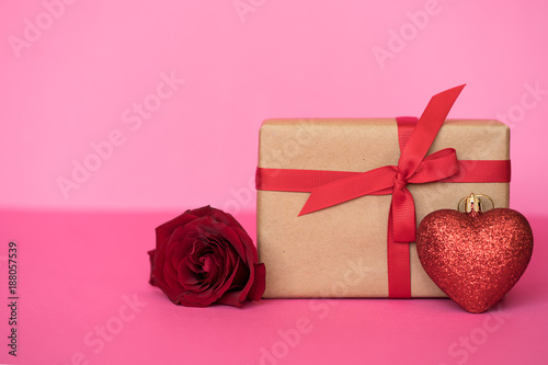 Romantic background with roses and gift box on pink.The concept of St. Valentine's Day, weddings, birthday or International Women's Day. - 188057539
