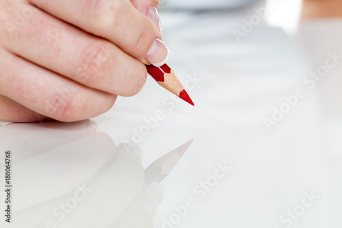 hand with red pencil - 188064768