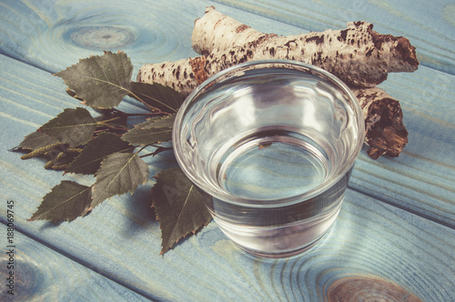 A glass of birch juice on wooden background - 188069745