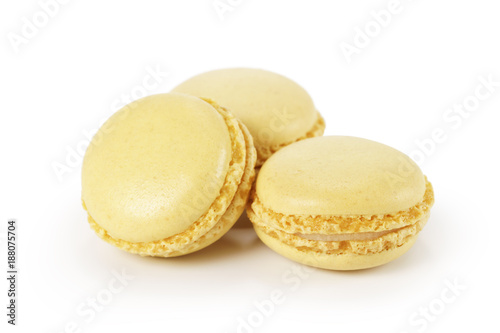 Fotobehang Macarons three yellow lemon macarons isolated on white