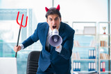 Devil angry businessman in the office - 188084344
