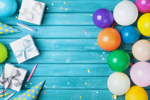 Foto Murales Birthday party banner or background with colorful balloon, gift, carnival cap, confetti and candy. Copy space.