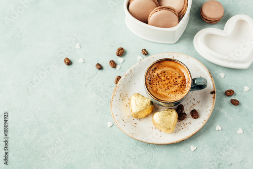 Cup of coffee with foam and macaroons. Delicious Breakfast