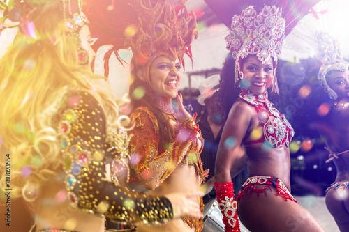 Height scale Brazilian women dancing samba music at carnival party
