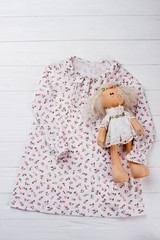 Dress and stuffed doll. Stylish nightgown with floral pattern, sleeves and collar. Gift for a little girl.