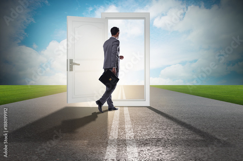 Foto Murales Businessman in front of door in business opportunities concept