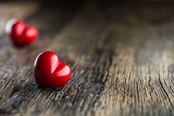 Valentines red heart. One two red heart on wooden table. Wedding or valentine day - 188100393