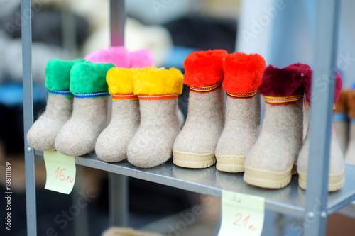 Foto Murales Colorful handmade woolen felt boots sold on Easter market in Vilnius