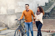 Happy young couple with a bicycle on sunny autumn day in the city - 188115593