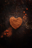 Truffles in heart shape, for valentine's day on old black metal background. - 188118996