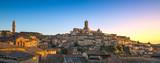 Siena sunset panoramic skyline. Mangia tower and cathedral duomo. Tuscany,