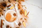 Traditional indian masala chai tea with spices - cinnamon, cardamom, anise, white background. Top view copy space - 188133373