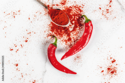 Fotobehang Hot chili peppers Raw fresh organic and dried ground chili pepper on white marble background top view copy space