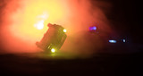 Toy BMW Police car chasing a Ford Thunderbird car at night with fog background. Toy decoration scene on table . Selective focus – 11 JAN 2018, BAKU AZERBAIJAN