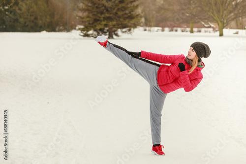 Foto Murales Woman wearing sportswear training boxing outside