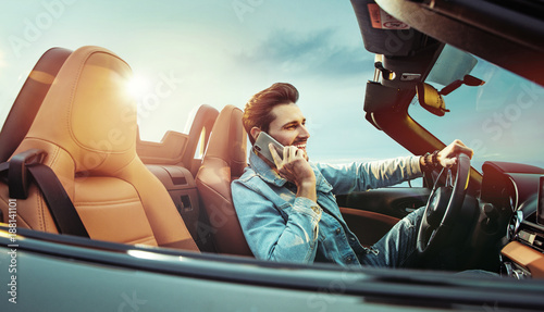 Fotobehang Konrad B. Handsome man riridng a convertible car