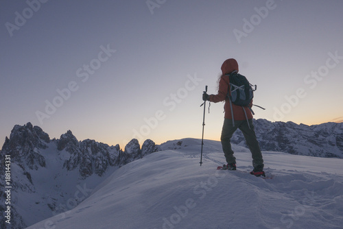 Foto op Canvas Lavendel Brave woman discovering alpine mountains alone at dusk